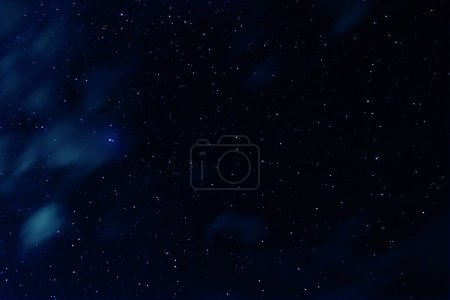 Long exposure photo of night sky with stars and clouds