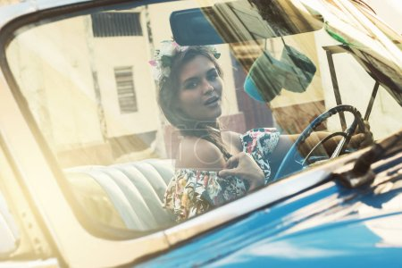 Photo for Beautiful woman driving a retro car - Royalty Free Image