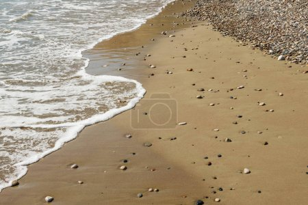 Photo for Pebble stones on sandy beach with sea wave - Royalty Free Image