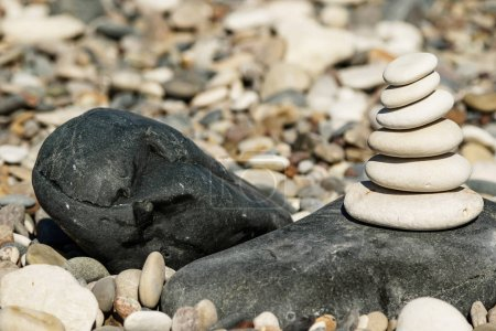 Stack of smooth round stones on the pebble beach