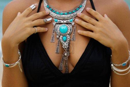 Woman wearing beautiful silver necklace