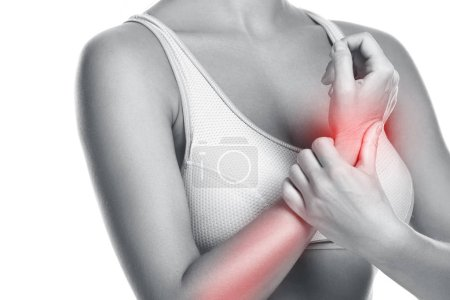 Woman feeling pain in her wrist over white background