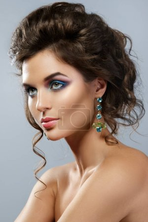 Photo for Portrait of gorgeous woman with a beautiful makeup and shiny earrings in studio - Royalty Free Image