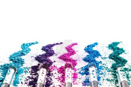 Photo for Crushed eyeshadows and make-up brushes on white background - Royalty Free Image
