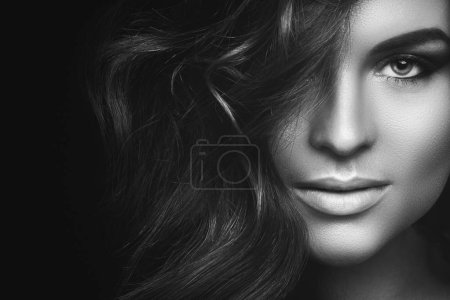 Black and white portrait of  Woman with curly hair and beautiful make-up