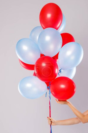 Many colorful balloons isolated on gray background
