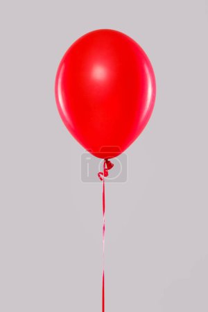 One red balloon isolated on gray