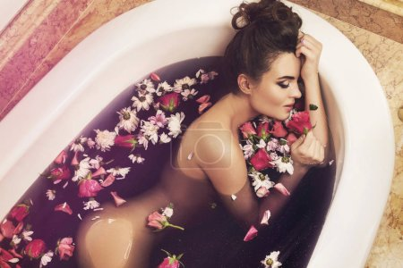 Photo for Beautiful woman in bath with flowers. Rejuvenation and relaxation concept - Royalty Free Image