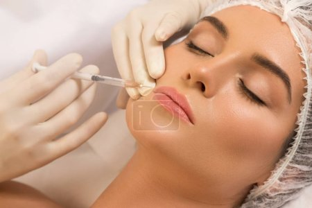 Woman during lips augmentation procedure.