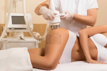 Woman during anticellulite massage or figure correction procedure