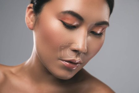 Asian woman with  beautiful make-up. Wet eyeshadows.