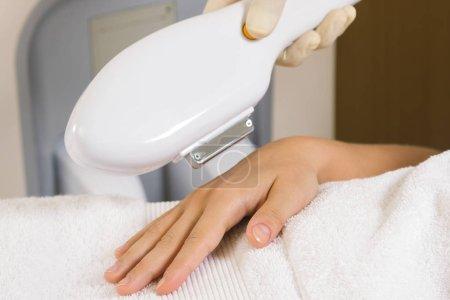 Woman during photoepilation or rejuvenation procedure