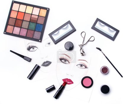 Photo for Face charts and different makeup objects and cosmetics on white background - Royalty Free Image