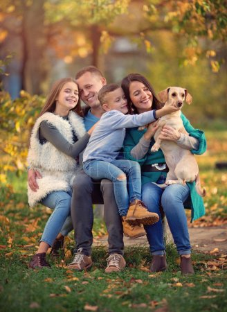 Photo for Autumn portrait of happy family having fun outdoors - Royalty Free Image