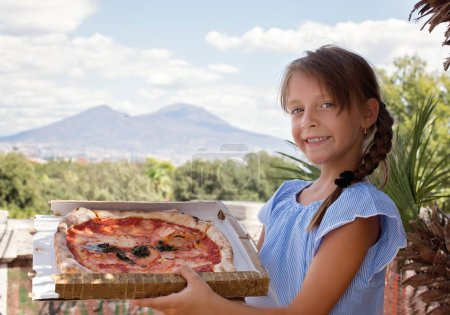 Photo for Cute little girl holding pizza - Royalty Free Image