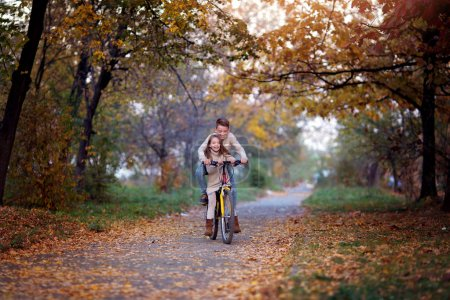 Photo for Closeup autumn portrait of cute brother with sister have fun together - Royalty Free Image