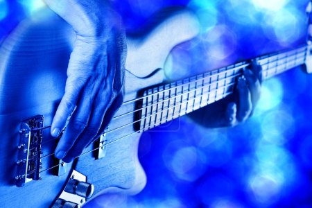 Photo for Rock bassist hands playing electric bass guitar live on stage - Royalty Free Image