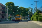 Montreal, Quebec, Canada, August 31, 2018. The North American yellow school bus transports schoolchildren, with information in French, according to the French rule of Quebec.