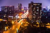 Eyeglasses against night cityscape background