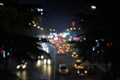 blurred view of night city at twilight
