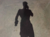 silhouette of a man in a black suit on the beach