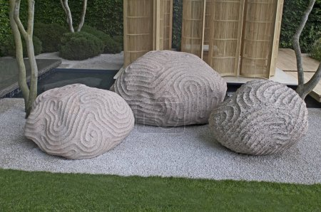 Sculpture showing the intervention of humans into nature in a garden setting