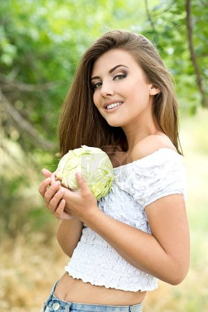 Photo for Happy girl holding fresh organic cabbage - Royalty Free Image