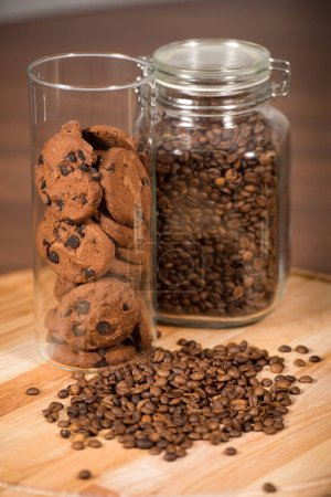 Photo for Close up of jar cookies and coffee beans on wooden table - Royalty Free Image