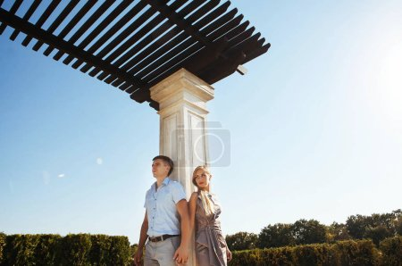 Photo for Stylish couple in love - a guy with glasses and a blonde - on a walk near the columns, positive emotions - Royalty Free Image