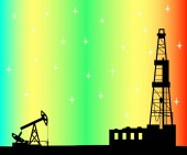 Silhouette of drilling rig and pump