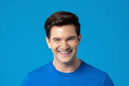 Young friendly smiling caucasian man in plain blue t-shirt