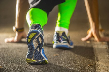 Photo for Low angle view of male athlete ready to run - Royalty Free Image