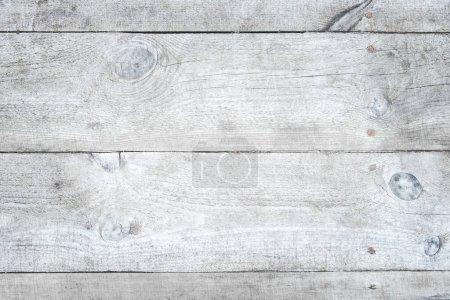 Alte rissige türkisfarbene Holzoberfläche schräg angeschossen