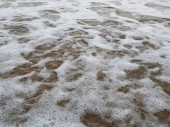 Close-up foam sea Atlantic ocean province of Huelva Isla Cristina Spain