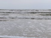 Beach, sand, foam of the sea, in Isla Cristina province of Huelva Spain. Atlantic Ocean