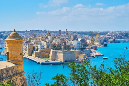The Grand Harbour of Valletta surrounded by massive medieval forts with bastions, watchtowers and counterguards, such as Senglea or Valletta forts, facing each other, Malta.