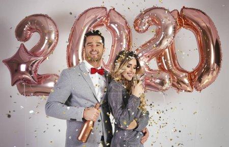 Photo for Loving couple celebrating New Year - Royalty Free Image