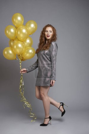 Photo for Woman with balloons looking at copy space - Royalty Free Image