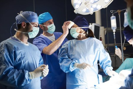 Photo for Tired surgeon during the operation at night - Royalty Free Image