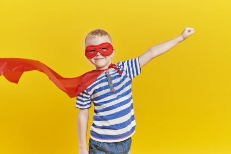 Photo for Portrait of playful boy in superhero costume - Royalty Free Image