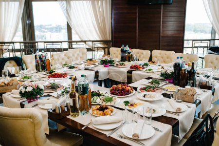 Photo for Served table with food in restaurant on wedding banquet - Royalty Free Image