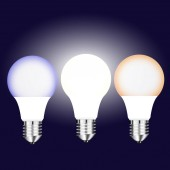 Vector drawing three bright LED lamps with different glow on a dark background