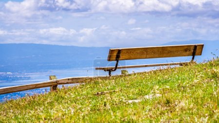 Photo for Wooden bench and vista point overlooking south San Francisco bay area and San Jose, California - Royalty Free Image