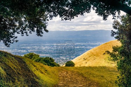 Photo for Hiking trail in South San Francisco bay area, residential areas of San Jose visible in the background, California - Royalty Free Image