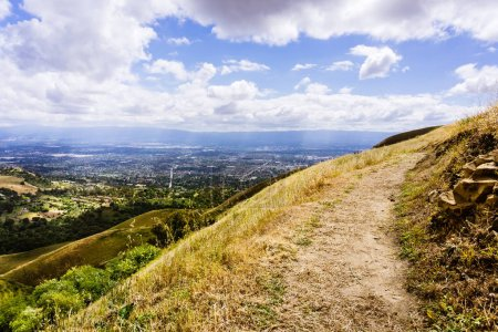 Photo for Hiking trail through the hills of south San Francisco bay area, San Jose visible in the background, California - Royalty Free Image