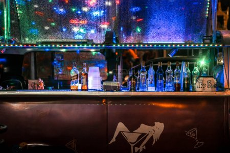 Photo for Bar counter with alcohol in neon light Pattaya Thailand - Royalty Free Image