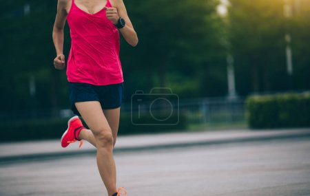 Young woman runner sportswoman jogging and running in urban training workout