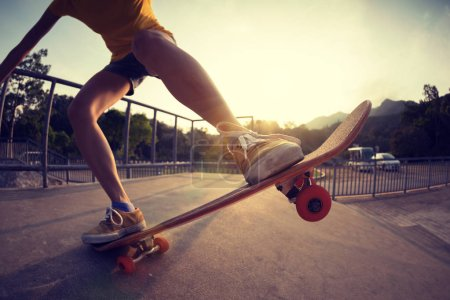 Photo for Cropped image of skateboarder skateboarding on skatepark ramp - Royalty Free Image