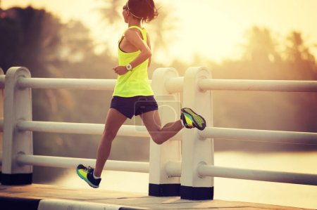 Photo for Woman runner sprinting outdoors. Sportive woman training outdoors. Healthy lifestyle and sport concepts - Royalty Free Image