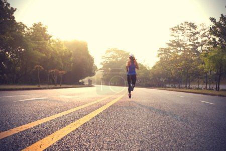 Photo for Runner athlete running on road. Workout concept - Royalty Free Image